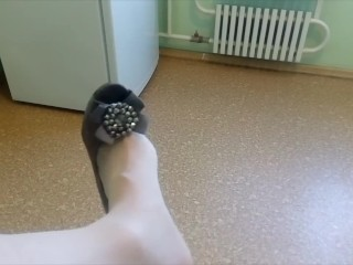 ladyboy plays a shoe in stockings